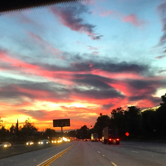 A beautiful Cali sunset across the freeway on my way to the airport.