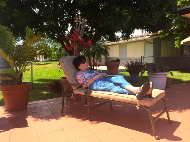 My grandmother lounging in the shade.